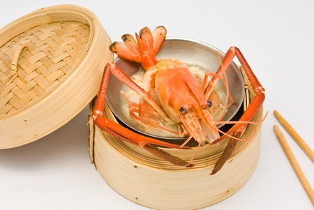 Chinese steamed shrimp dimsum in bamboo containers traditional cuisine photo
