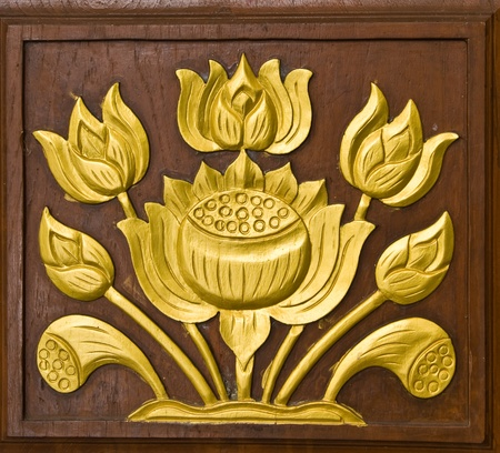 lotus temple: lotus carved gold paint on temple door