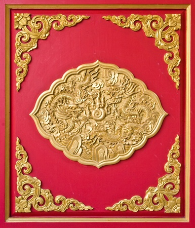 golden dragon decorated on red wood wall,chinese style in temple at Wat-Leng-Noei-Yi2 , Bang-Bua-Thong, Nonthaburi, Thailand photo