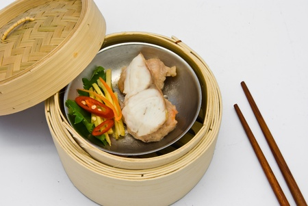 Chinese steamed dimsum fish in bamboo containers traditional cuisine photo