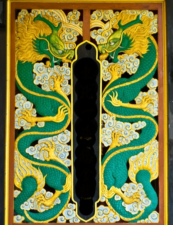 naga china: dragon carve gold paint in temple wall Stock Photo