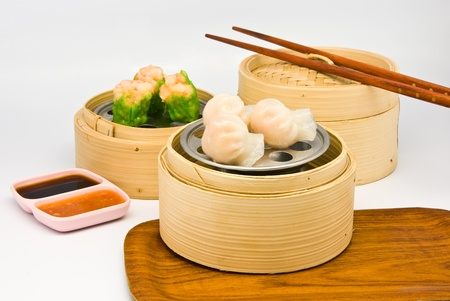 Chinese steamed dimsum in bamboo containers traditional cuisine Stock Photo