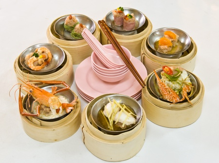 china cuisine: Chinese steamed dimsum in bamboo containers traditional cuisine Stock Photo