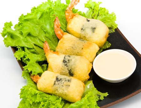 Shrimp fried seaweed roll on the plate. photo