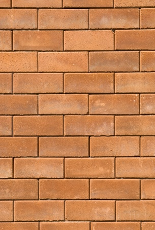 red brick wall texture in vertical view photo