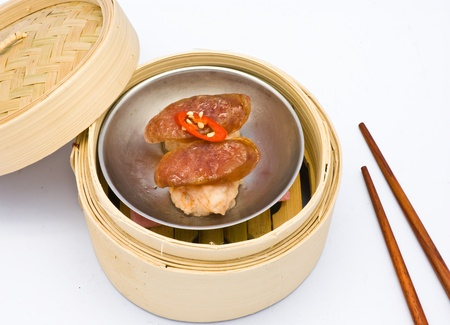 Chinese steamed dimsum sausage in bamboo containers traditional cuisine photo
