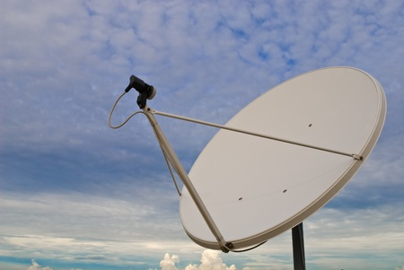 astrophysics: parabolic antenna on a background of sky Stock Photo