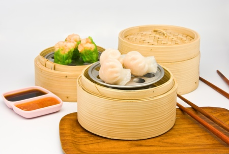 Chinese steamed dimsum in bamboo containers traditional cuisine Stock Photo - 9101910