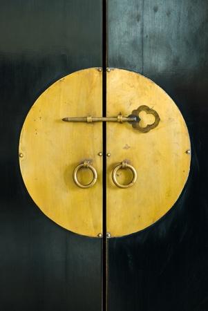golden key in the door of old cabinet wood Stock Photo - 9450928