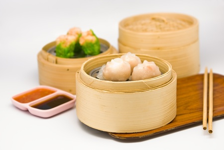 steamed: Chinese steamed dimsum in bamboo containers traditional cuisine Stock Photo