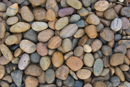 smooth stones: wall pattern of gravel stone Stock Photo