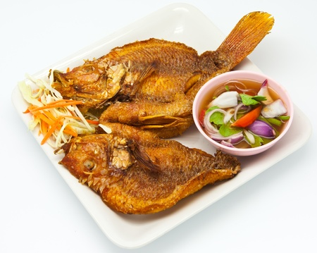 fish fry: Fried snapper with chili sauce on the plate