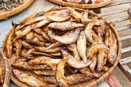 Dry Sheatfish, in a circle on bamboo plate,Siluridae Stock Photo - 9608766