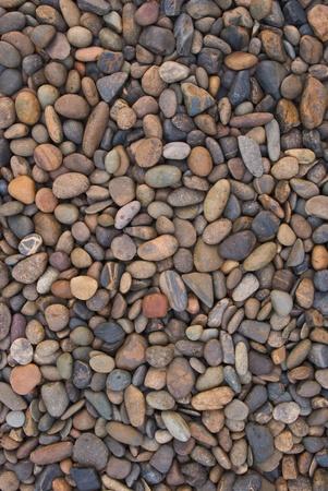 concrete surface finishing: wall pattern of gravel stone Stock Photo