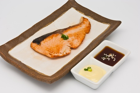 Salmon fish grilled in the plate on white background Stock Photo - 9731168