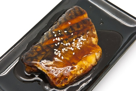 Japanese food style , Saba fish grilled with sauce in  the plate on white background Stock Photo - 9731174