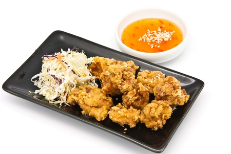 fried chicken in black plate with sauce on white background Stock Photo - 9765898