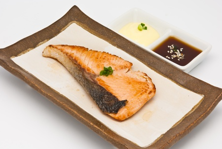 Salmon fish grilled in the plate on white background Stock Photo - 9765910