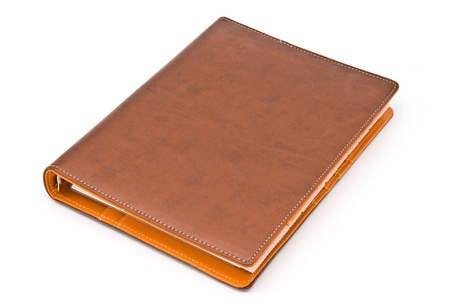 Brown notebook isolated on white background photo