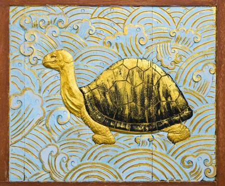 turtle carve gold paint in temple wall