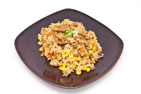 fried rice with pork and vegetable on the plate, japan food style photo