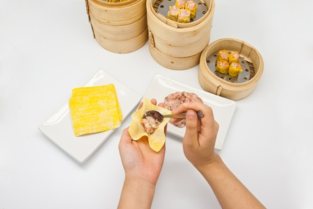 Manufacture of dim sum on white background photo