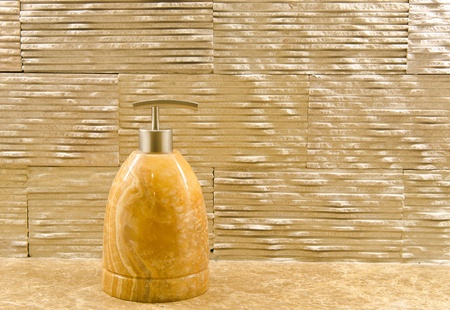 The cosmetic marble bottle on wall background photo