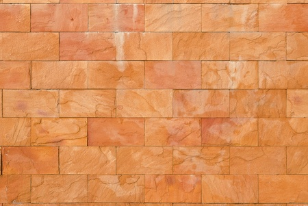Background of decorate sand stone wall surface photo