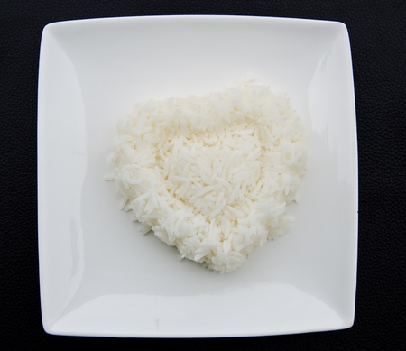 food staple: White steamed rice in white square  bowl