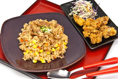 Bento, Japanese food style , fried chicken and  fried rice on white background photo
