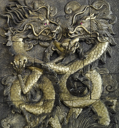 stucco golden dragon on the temple wall, Thailand photo
