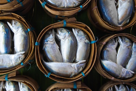 Mackerel fish in bamboo basket at market, Thailand photo