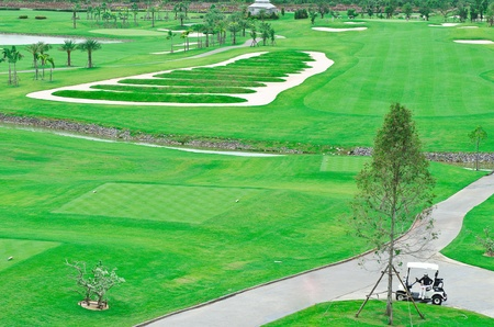 Beautiful landscape picture of a golf court with trees photo