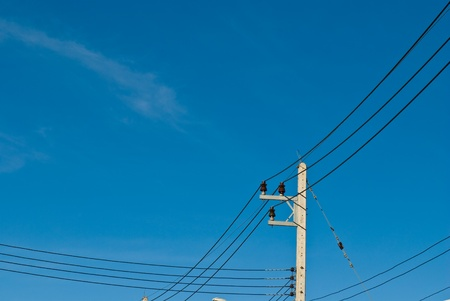 electricity post in blue sky at thailand photo