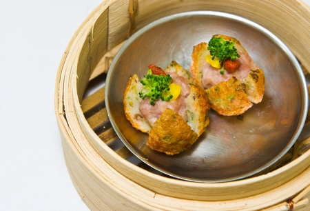 Chinese steamed dimsum in bamboo containers traditional cuisine photo
