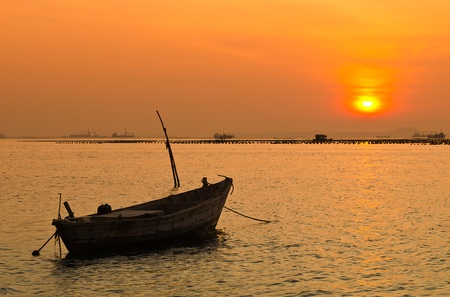 boat at sunset, Phukrt, south of Thailand photo