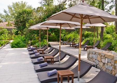 Beach chairs and umbrella at Phuket, Thailand