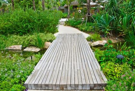 view of old wood bridge in the garden Stock Photo - 12177683