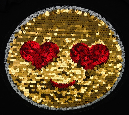 red heart eye on gold decorate metal photo