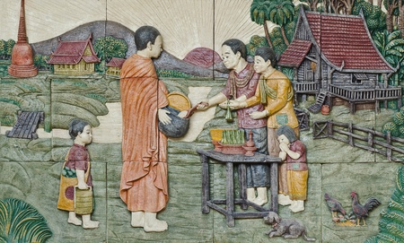 native culture Thai stucco on the temple wall,  Thailand, give food offerings to a Buddhist monk Stock Photo - 12177740