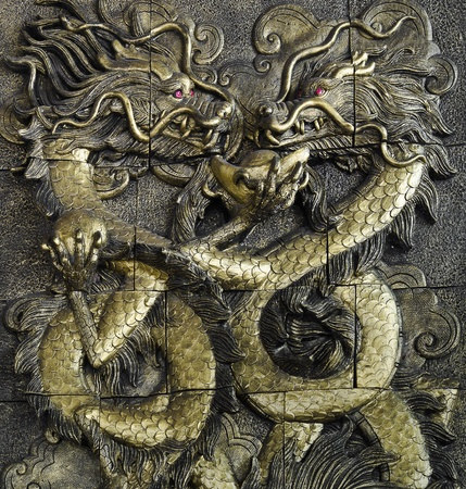 stucco golden dragon on the temple wall, Thailand Stock Photo - 12177741