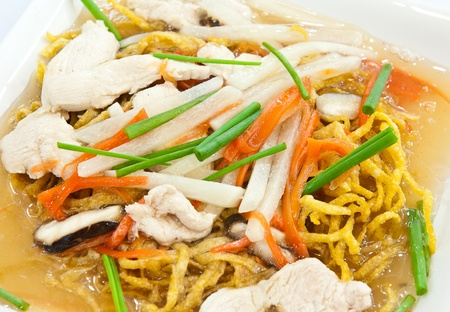 Rat-na,Yellow noodle and pork in Thai-Chinese style food photo