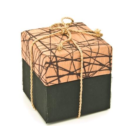 messaline: brown fabric box on white back ground.