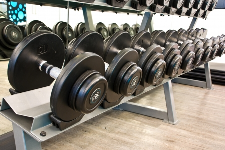 dumbbell in fitness room  Stock Photo - 12684752