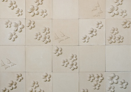 pattern of decorative sand stone wall with flower photo