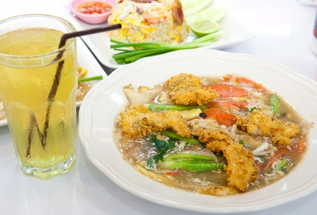 Rat-na, Soup Golden mushroom and fried chicken in Thai-Chinese style food photo