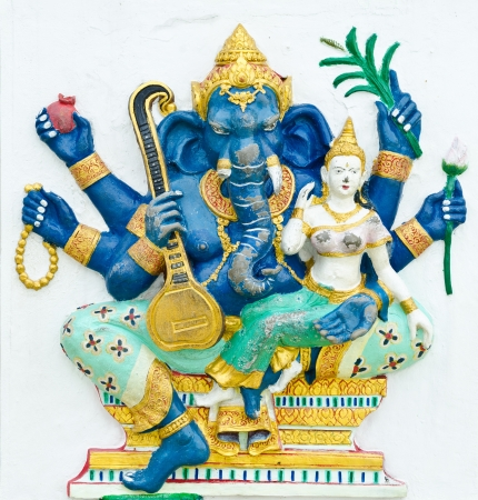 God of success 8 of 32 posture. Indian style or Hindu God Ganesha avatar image in stucco low relief technique with vivid color,Wat Samarn, Chachoengsao,Thailand. Stock Photo - 14362736
