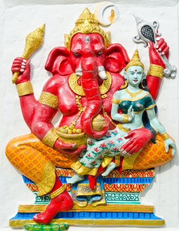 siddhivinayaka: God of success 19 of 32 posture  Indian style or Hindu God Ganesha avatar image in stucco low relief technique with vivid color,Wat Samarn, Chachoengsao,Thailand  Stock Photo