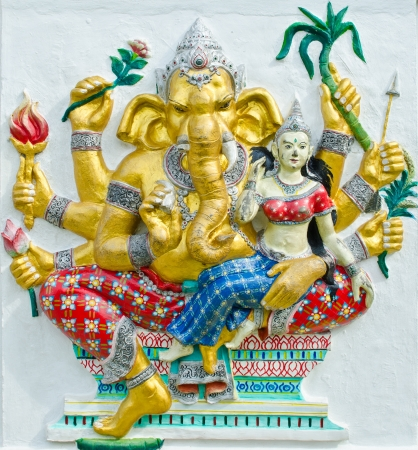 siddhivinayaka: God of success 30 of 32 posture  Indian style or Hindu God Ganesha avatar image in stucco low relief technique with vivid color,Wat Samarn, Chachoengsao,Thailand