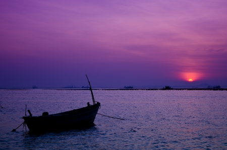 silhouette longtail  boat on the sea at sunset, Phuket, south of Thailand photo